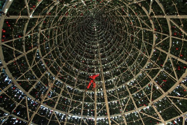 Abseiling around the inside structure of the tallest Christmas tree installation in the UK to check the wiring