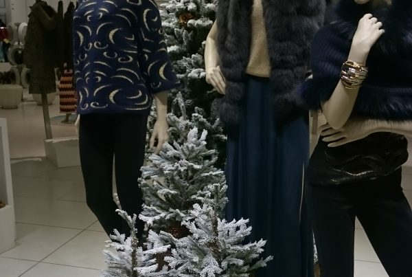 Christmas trees placed alongside store mannequins in the Harrods Heathrow Terminal 5 boutique