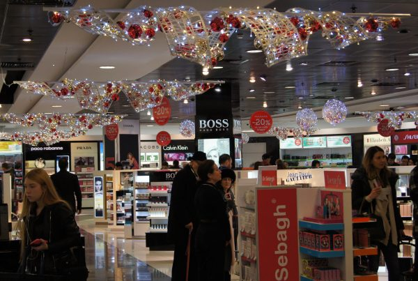 Fibreglass ribbon displays with Christmas baubles and lighting suspended from the ceiling