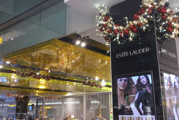 World Duty Free interior decorated with multiple hanging baubles and flickering star lighting
