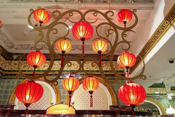 Lit lanterns celebrating Chinese New Year in the food hall at Harrods Knightsbridge