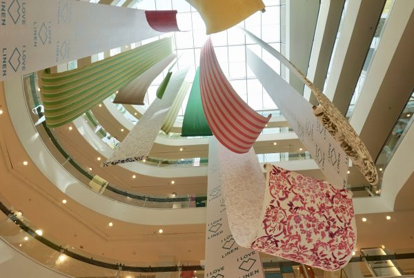 Linen display installation suspended from the top floor in the John Lewis atrium