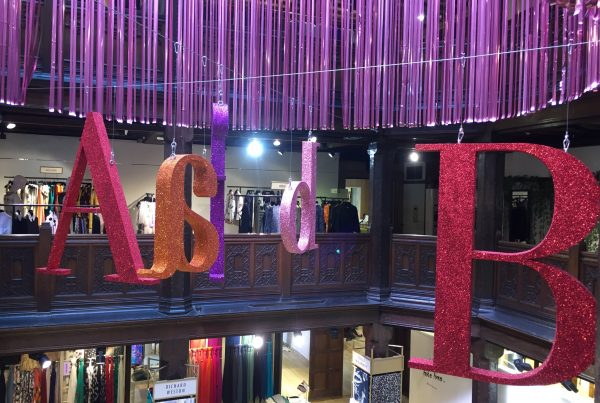 Life-size letters suspended from the ceiling at Liberty London