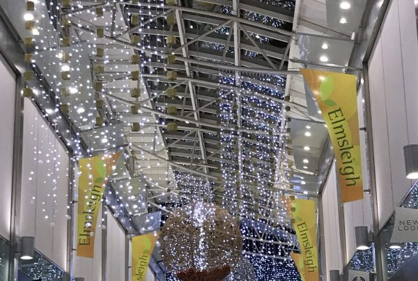 Light curtains suspended from the ceiling to illuminate the walkway in the Elmsleigh Centre