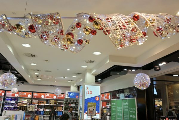 Fibreglass ribbon with baubles and interwoven lighting