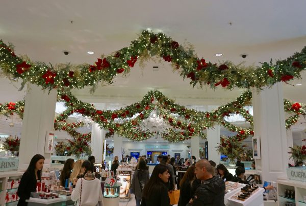 Harrods interior with lit garlands draped across the ceiling to add festive cheer