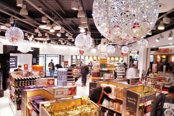 World Duty Free Gatwick with large Christmas decorations hanging from the ceiling