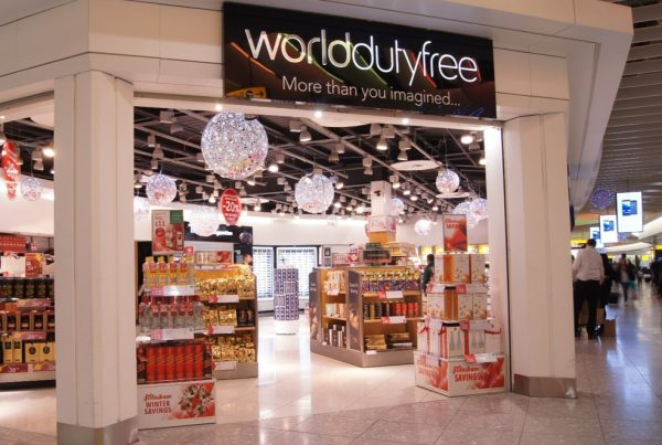 World Duty Free Gatwick entrance with large Christmas decorations hanging from the ceiling